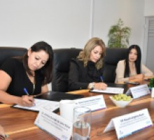 Comisionadas de IMIPE e IACIP durante la firma de convenio